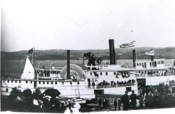 Summer picnicking along the St. John River formed a big part of the business for the riverboats by the early 1900's. Here we see the Victoria and other steamers moored near a picnic grounds.
