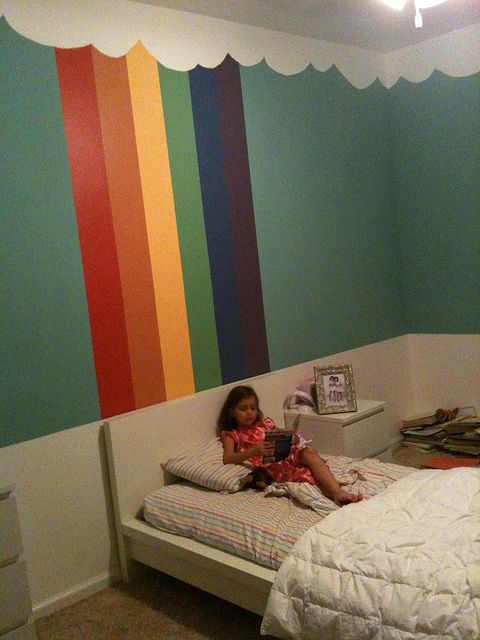 Add white scalloped border at the top & rainbow stripes on one wall.  (Use paint samples!) WAY CUTE!
