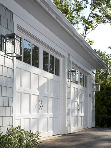 Nice garage doors, pretty handles, nice idea to make it not look so garagie.