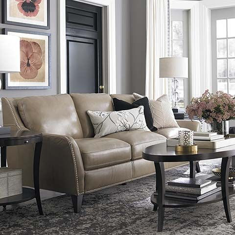 Sofa - love that it's leather (great for the dogs), the color, the shape, and the little sparkle of the silvery nailheads.