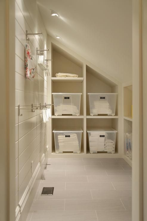 Cottage Mudroom Features A Sloped Ceiling Fitted With Pot