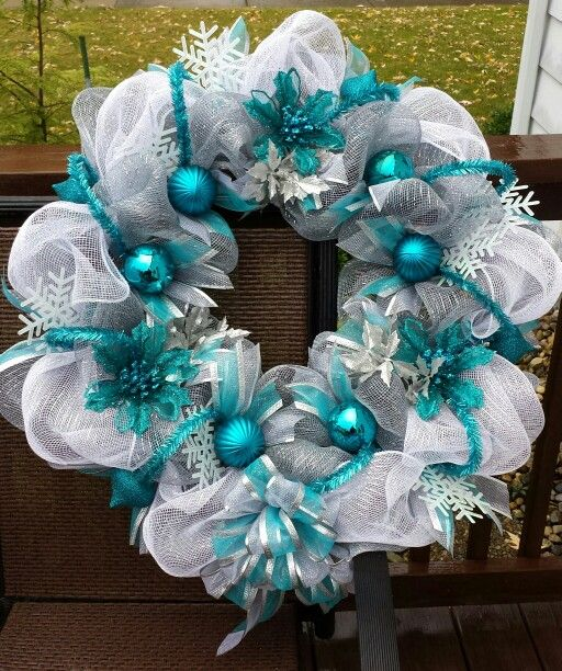 Silver, white and turquoise winter deco mesh wreath.