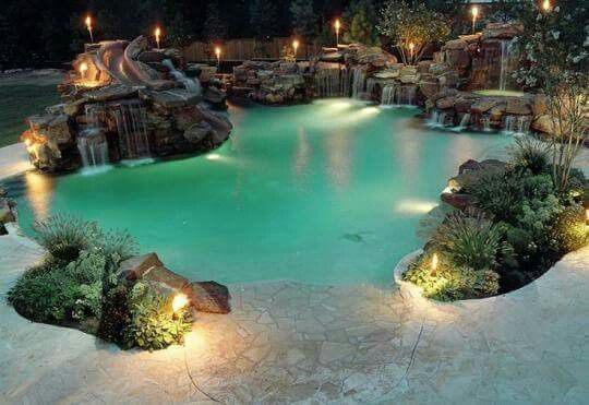 Epic pool Love the beach type entry and subtle waterfalls. Natural looking and not boulder boulder of rock rock rock.