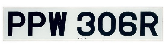 A prop car registration number plate from the Lotus Esprit in The Spy Who Loved Me, auctioned at 50 Years of Bond - The Auction