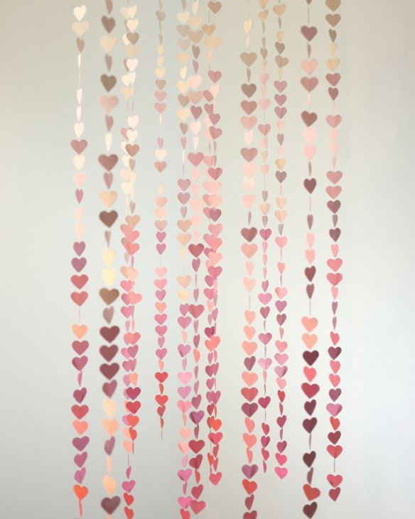 mini-heart-garland. @Emily Boyle I'm thinking multi sized and multi colored vertical lengths for the valentines day photoshoot.