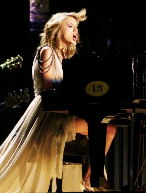 Taylor Swift performs onstage during the 56th GRAMMY Awards at Staples Center on January 26, 2014 in Los Angeles, California.