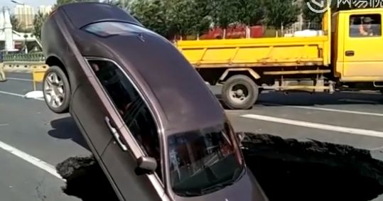 $750k Rolls-Royce swallowed up after sinkhole suddenly appears in Chinese street (Video)