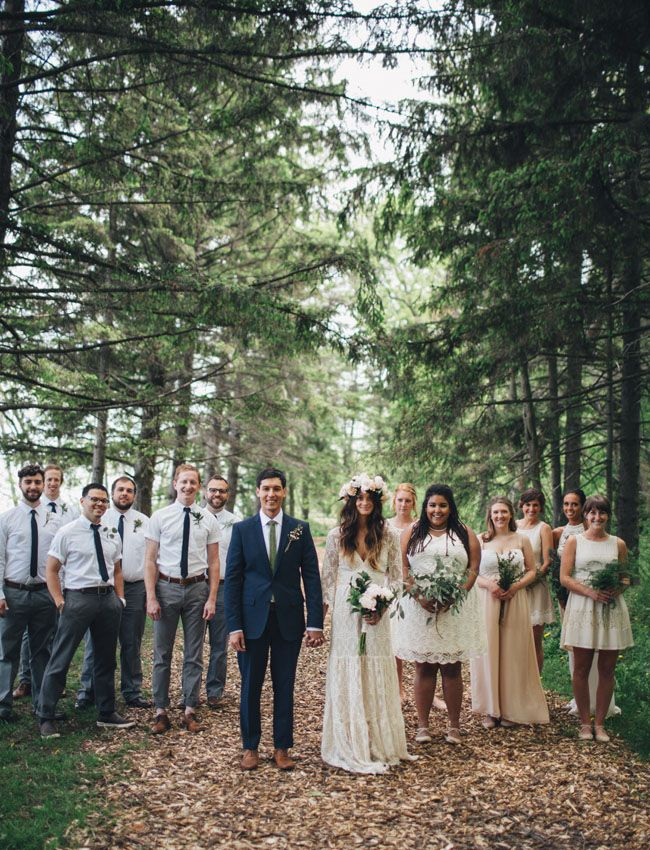 Simple navy blue suit, white shirt and green tie for the groom matched with grey trousers and white shirts and navy ties for the boys.  Milwaukee backyard wedding