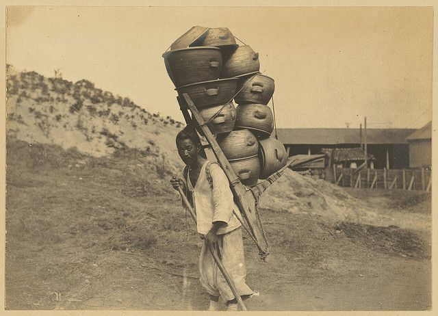 [Porter carrying clay pots strapped to A-frame on his back] | Collection: Willard Dickerman Straight and Early U.S.-Korea Diplomatic Relations, Cornell University Library. c1904