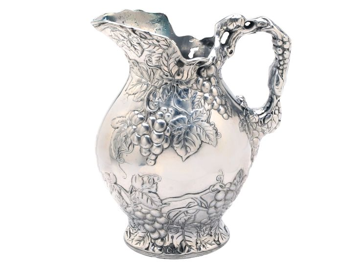 Inspired by the bounty and beauty of California's famous Napa wine region, this traditional pitcher is covered in sculptural grape leaf designs, from spout to handle.