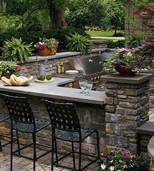 I have ALWAYS (!!!!) wanted a backyard patio with a grill/bar-counter top like this. A girl can dream, can't she?