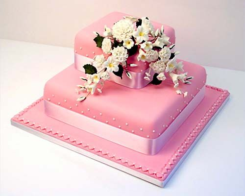 two tiered square wedding cake ideas wo tier square pink fondant wedding cake decorated with 21337