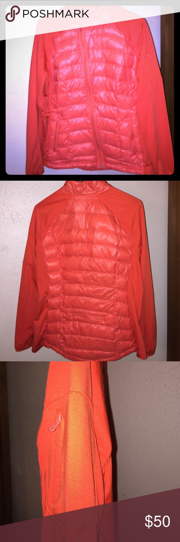 Calvin Klein zip up down jacket Orange Calvin Klein versatile down jacket, 90% duckdown, 10% Waterfowl feathers. Nylon body, 92% polyester and 8%spandex sleeves with hole for thumbs. Worn a couple of times, in great condition and looks new. Size XL womans. Calvin Klein Jackets & Coats Puffers