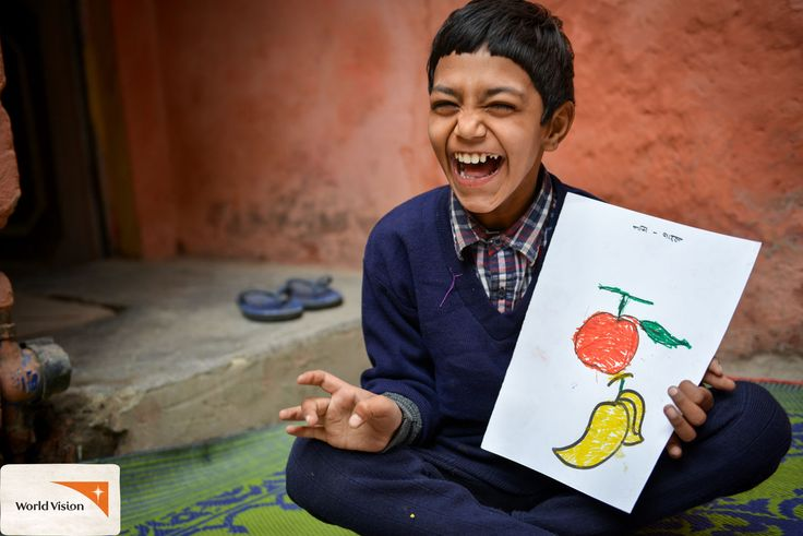 """Sponsored child Badal from #India proudly shows the #colouring he did during class at the #WorldVision centre he attends for child with special needs. """"I love the centre and the teachers who teach me here. They treat me well. They love me and I love them,"""" says Badal. #disability Photo by Annila Harris, World Vision"""