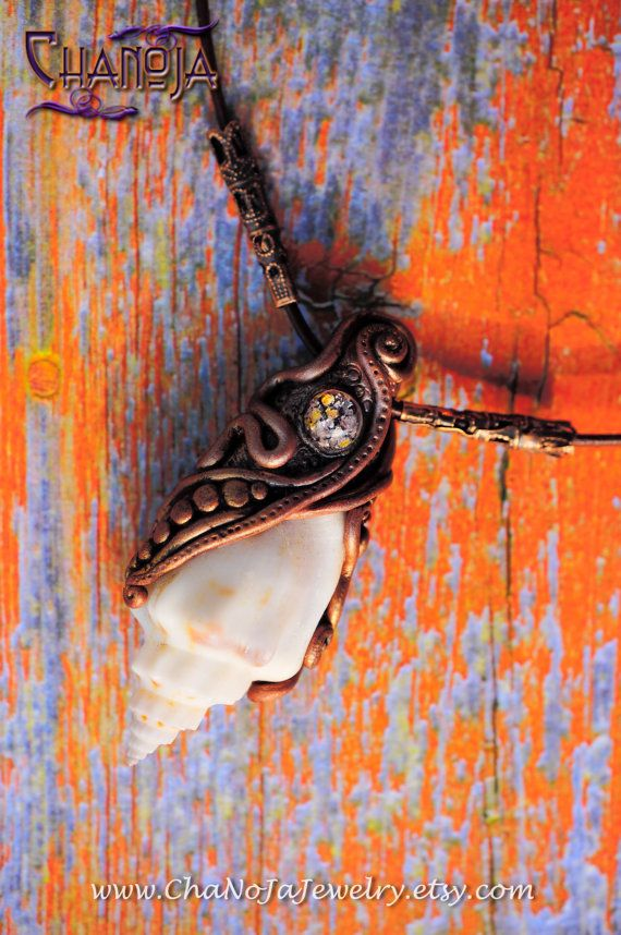 """Whispering Sea Shell Pendant-by Chanoja. """"The Sea, once it casts its spell, holds one in its net of wonder forever."""" Jacques Ives Cousteau / Gorgeous seashell pendant with carefully handcrafted copper swirls and a sparkly glass jewel. It carries such a mystical energy - makes me dream of a far away paradise beach right away. Would make a perfect addition to your ocean and nature inspired jewelry collection."""