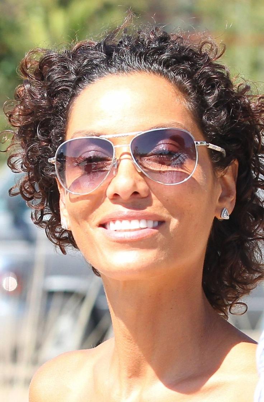 Nicole Murphy. Wavy hair, diamond studs and aviators, perfect combo.