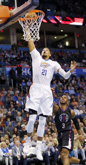 Oklahoma City's Andre Roberson (21) goes up for a dunk in front of L.A.'s Chris Paul (3) during an NBA basketball game between the Oklahoma City Thunder and Los Angeles Clippers at Chesapeake Energy Arena in Oklahoma City, Friday, Nov. 11, 2016. Photo by Nate Billings, The Oklahoman