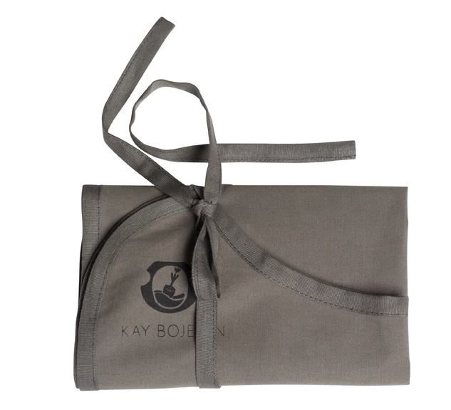 The bib - beautiful, classy and practical. Child set 2-pieces; pusher and handle spoon. Wrapped in a canvas bib. Kay Bojesen Grand Prix cutlery / flatware. Danish design.