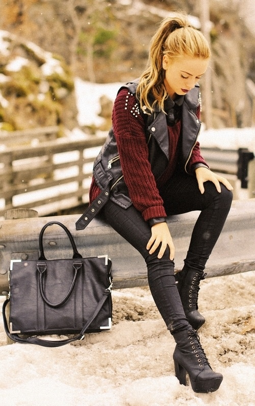 Burgundy sweater under a leather vest. Don't like the studs, and would prefer lower-heeled, Doc-Marten type of combat boots. Maybe not so tight skinny jeans, either. But I love it!