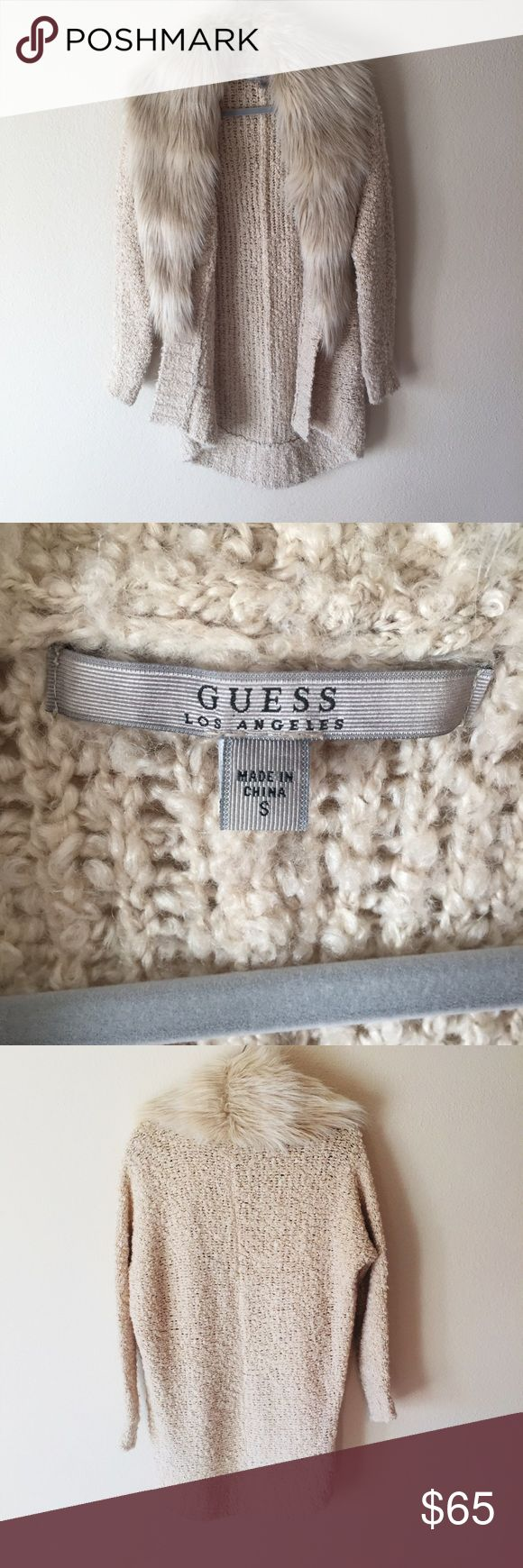 Guess women's size small beige sweater w/ faux fur Guess women's size small beige/cream color sweater w/ faux fur attachment. Hand wash cold. Very comfortable and cozy sweater. Love the button faux fur attachment- can dress if up or down! Guess Sweaters Cardigans
