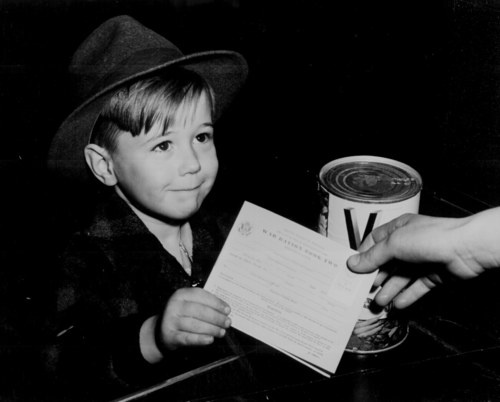Boy using ration stamps.
