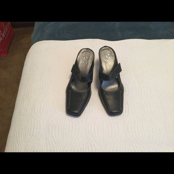 "REDUCED Aerosoles mule pumps Black with grey contrast stitching. Velcro tab adjuster. Heel height is 2 3/4"". Never worn. AEROSOLES Shoes Heels"