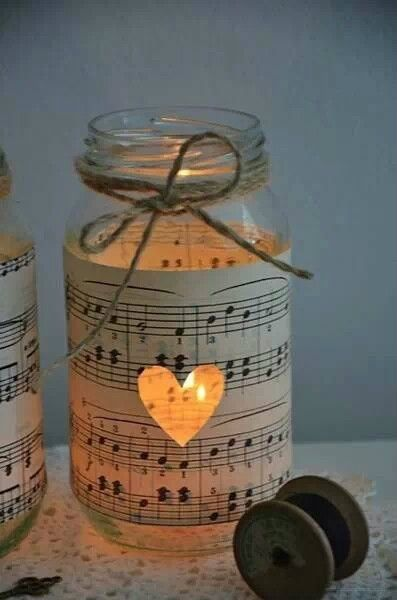 DIY candle holder. Get an old music sheet, cut a love heart in the middle and cover the jar. LIght from the candle glows out. Cute romantic idea