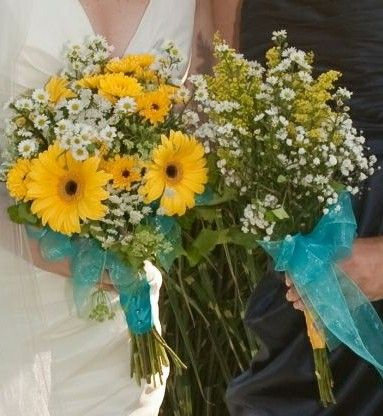 Bride's Bouquet: Yellow Gerbera Daisies, Yellow Daisies (Chrysanthemums), White/Yellow-Green Asters, Queen Anne's Lace, Greenery   Bridesmaid's Bouquet: White/Yellow-Green Asters, White Gypsophila, Yellow Solidago