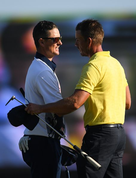 Justin Rose of Great Britain shakes hands with second placed Henrik Stenson of Sweden after the the Men's golf competition...