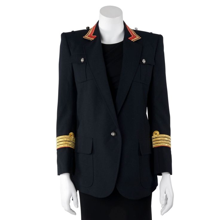 A Balmain Black Wool Blend Military Jacket. Take a new twist on that wardrobe essential black jacket. This black wool-mix military jacket from Balmain features peaked lapels with red and gold trims, gold piping at ...