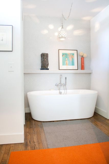 white subway tile, soaking tub, and chandelier--apartment therapy