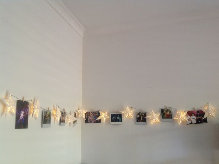 Adding simple interest to an otherwise boring white corner... Bunnings paper star string lights ($12), tiny craft pegs from variety store ($2) and my old Polaroid pictures.