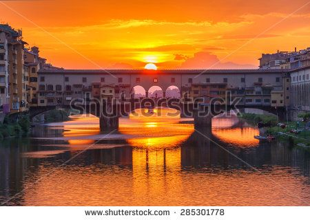 River Arno and famous bridge Ponte Vecchio at sunset from Ponte alle Grazie in Florence, Tuscany, Italy