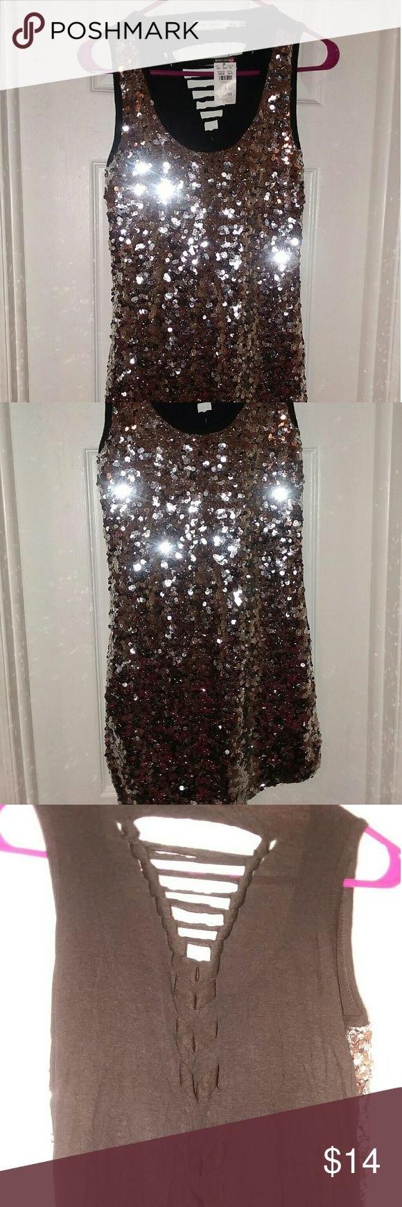 Silver sequined dress NWT Silver and Black sequined dress. Perfect for a semi-formal, cocktail dress, or girls night out!! Front is top to bottom  Silver sequined and back is a peek-a-boo criss  cross  pattern  down the middle of back. Material had some stretch so it gives for comfort with wear. Body Central Dresses Mini