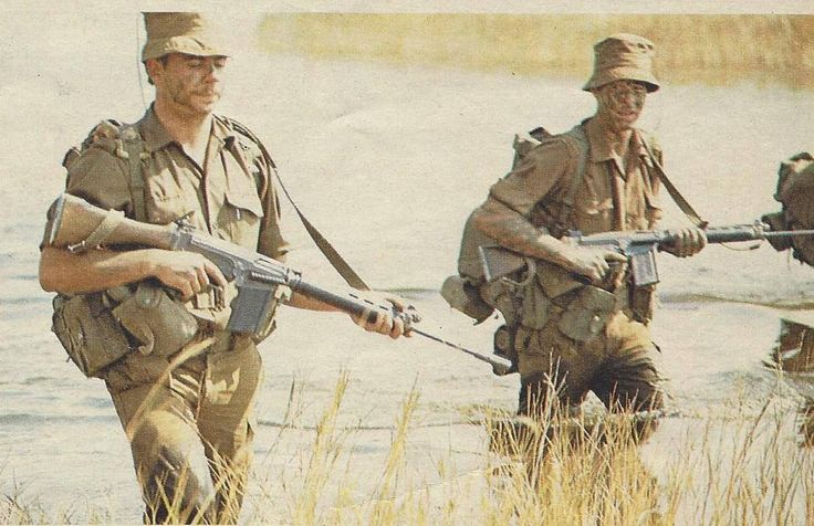 titovka-and-bergmutzen:  SADF troops with their R1 rifles on patrol, mid-1970s.