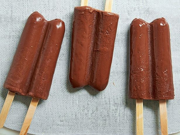 Greek Yogurt Fudge Pops : These chocolatey fudge pops made with semisweet chips can be enjoyed guilt-free, thanks to a mix of reduced-fat Greek yogurt and low-fat milk.