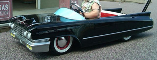 tricked out cadillac baby stroller has fire coming out of the tailpipes pedal car air ride and cars