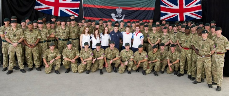 1 Rifles soldiers with Team GB gymnasts: (Left to right) Jennifer Pinches, Rebecca Tunney, Hannah Whelan, Sam Oldham, Max Whitlock and Daniel Purvis take time to meet soldiers at the North Greenwich Arena on the final day of the London 2012 gymnastic events. Photographer: Sgt Alison Baskerville; Crown Copyright.