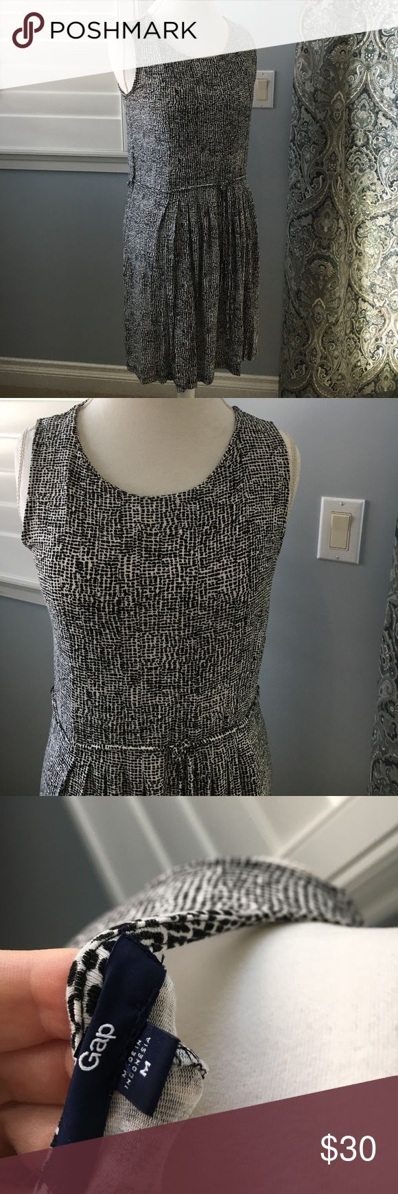Jersey knit Gap dress Super cute black and white jersey knit dress from the Gap. This dress is not lined but is not see through. This is a comfy and cute dress to throw on for any reason including the beach :) GAP Dresses