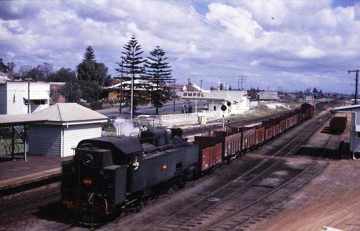 A goods train passes through Bassendean Station...