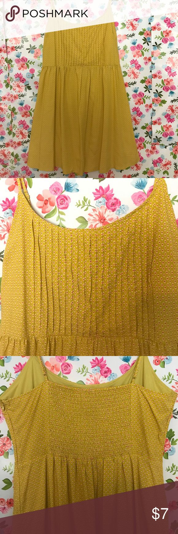 """Old Navy spaghetti strap yellow polka dotted dress This yellow (midway between """"canary"""" and """"mustard"""" 😉) dress would be perfect for summer cook outs or could even be paired with a light cardigan and cowboy boots for tailgating in the fall. It is patterned with pink polka dots and features a ribbed back to provide some extra room if needed. Straps are adjustable, hidden side zipper with eyelet closure. Size XL, but fits more like a XXL. Old Navy Dresses Midi"""