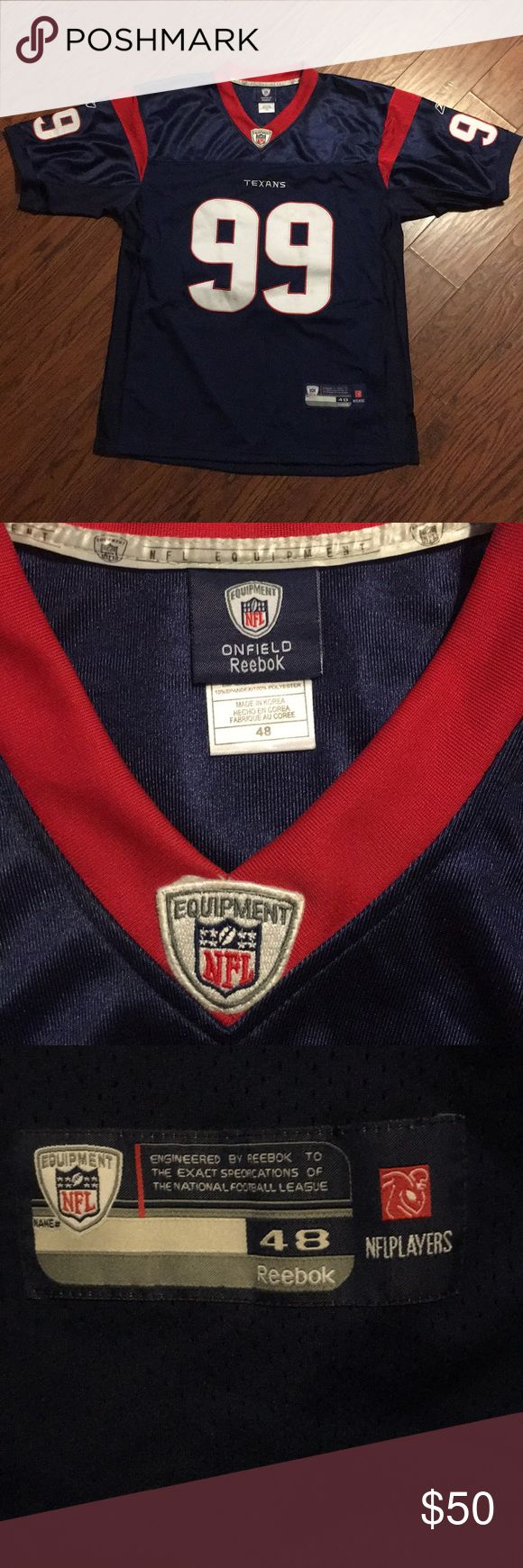 """JJ Watt Texans Jersey #99 JJ Watt Texans Jersey. As seen in the pictures there are a few stain spots on the numbers on front. You may be able to get it out with some spot bleach cleaner, I just haven't tried. Men's size 48, measures 24"""" armpit to armpit Reebok Shirts"""