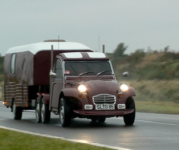 Citroen 2CV with modded exhaust and trailer.  Wonder how slow that is....