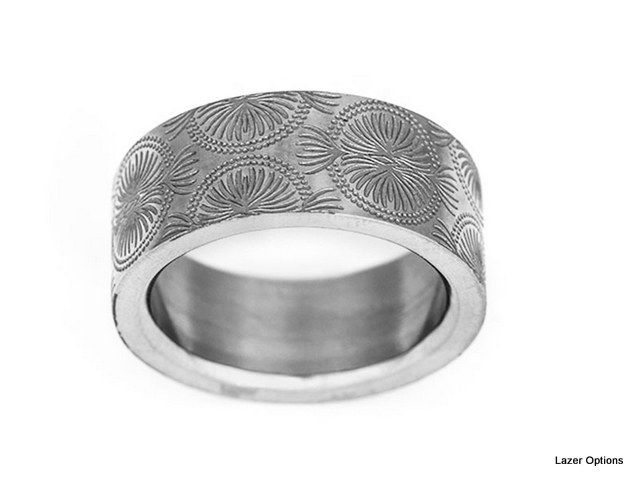 African Textile design Laser engraved on Stainless steel ring..