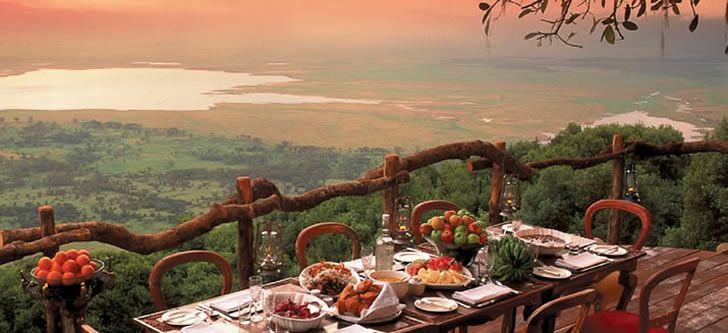 Stunning views at dinner on a luxury safari. Ngorongoro Crater Lodge, Tanzania