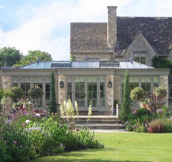 Beautiful orangery with stone piers and breakfront