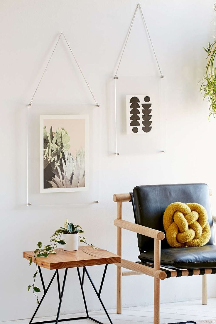 Acrylic Hanging Display Frame from Urban Outfitter. Also totally DIY-able!
