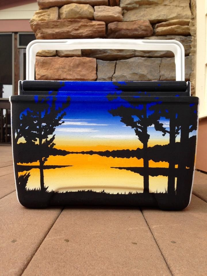 Painted cooler idea: bright lake sunset and tree silhouettes.