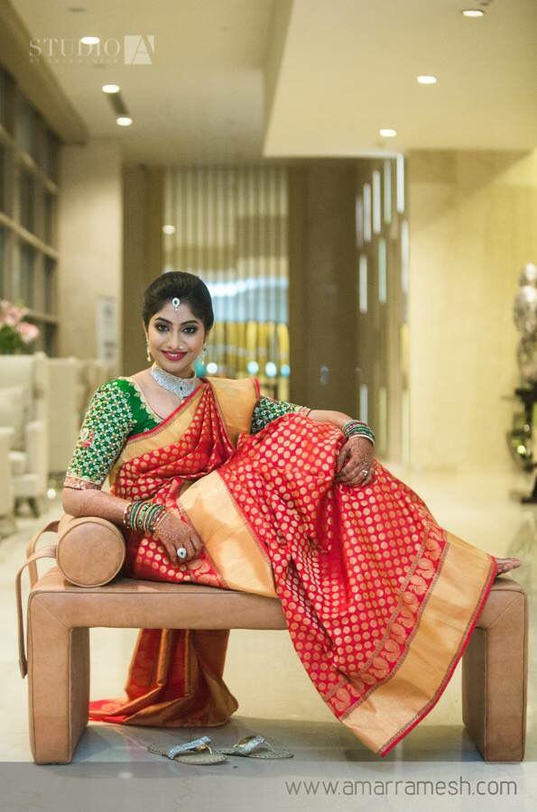 Red saree with green blouse..classic combination