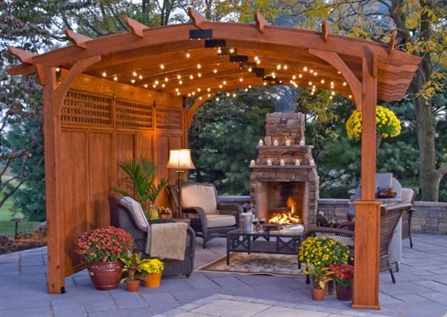 pergola ideas. love the stone fireplace.